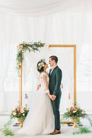 wedding backdrop frame gold frame wedding backdrop accented with rustic flowers
