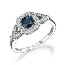 unique engagement ring blue sapphire white gold diamonds leaves