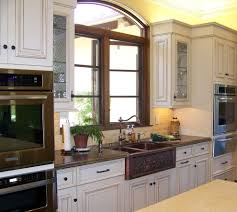 decorating brown apron sink on white kitchen cabinet with black