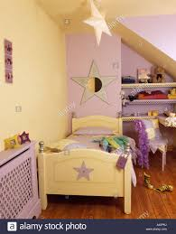 yellow and purple bedroom descargas mundiales com child s bedroom with pastel yellow and purple walls and pale yellow bed with star motif