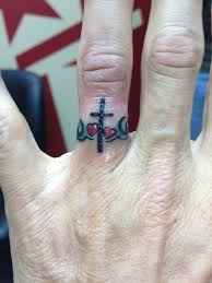 a rocking by astonishing ring tattoos