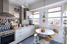 inside the bohemian home of an interior designer nonagon style kitchen of a bohemian home with geometric tiles and city view nonagon style