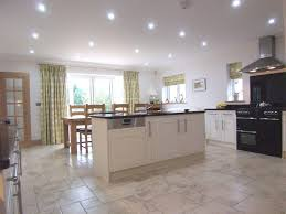 kitchen island plan photo of open plan black with kitchen island and range cooker