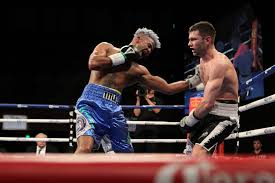 solar plexus punch boxing barthelemy digs deep to win a tough ud