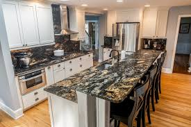 white kitchen cabinets with black countertops white cabinets paired with countertops marble