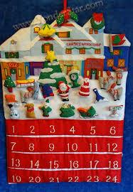 lighted santa s workshop advent calendar madelaine s chocolates set of 24 foil wrapped christmas presents