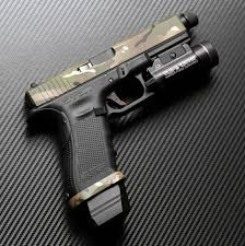 glock 17 with aac ti rant suppressor trijicon rmr surefire x400