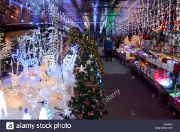 decorations sale display of illuminated christmas decorations on sale in a garden