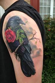 2 ravens one holding a heart and the other a mirror tattoo