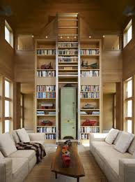 vaulted ceiling living room living room with vaulted ceiling and large central bookcase in