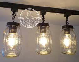 mason jar track lighting fixture trio with vintage quarts