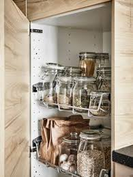 ikea kitchen organizers the space under the kitchen sink is updated with new storage that
