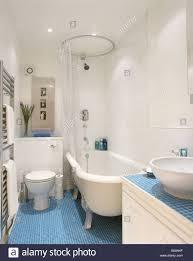 bathrooms interiors showers town stock photos bathrooms circular shower rail on white clawfoot bath in modern white bathroom with blue mosaic tiled floor