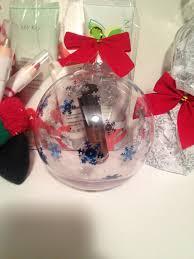 nourishine lip gloss inside a clear ornament