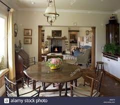 dining room with round dining table and views through to the
