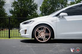 white tesla model x sits on gold vossen forged wheels autoevolution