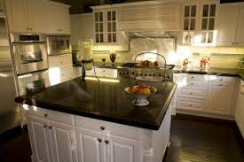 white kitchen island with black granite top granite countertop serving table pictures of flowers in vases
