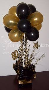 black and gold balloon centerpiece bing images henni party