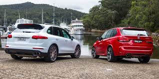 porsche dark red 2015 bmw x5 m vs porsche cayenne turbo