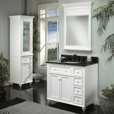 white lacquer teak wood floor bathroom vanity with black marble