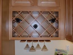 kitchen cabinet with wine glass rack beige wooden kitchen cabinet integrated with crossed wine rack