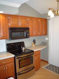 kitchen design with glass window white cabinet and gray color also