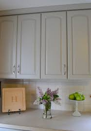 a kitchen cabinet makeover about updating the countertops painting the wood trim and other such improvements but it is easy to see how just changing the color of the cabinets