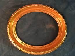 vintage carved solid wood oval frame gilded with applied