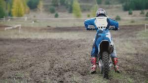dirt bike motocross videos motocross racer starting engine of his dirt bike riding away