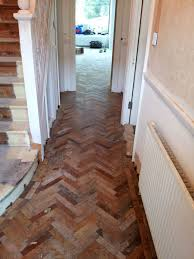 afrormosia reclaimed parquet fitting and sanding in tooting