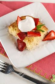 tres leches cake with strawberries garnish with lemon
