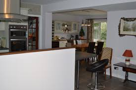 design white kitchen and dining with open floor plan wooden