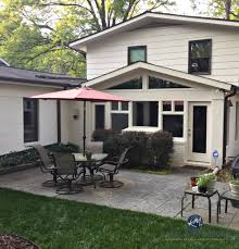 exterior painted brick and siding in ballet white dark brown