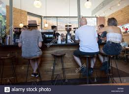 customers sitting at the bar in the trendy pure black coffee shop