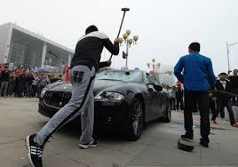 maserati dealership man destroys 423 000 maserati at china auto show because he was