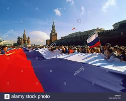 a giant russian flag in red square celebrating the victory of the