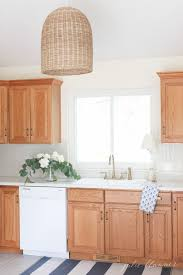 tips for painting oak kitchen cabinets tips and tricks to update dated oak kitchen cabinets without