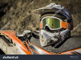 motocross style helmet dirty motorcycle motocross helmet goggles stock photo 249272383