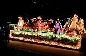 christmas light parade floats don t get left in the dark lighted christmas parade float entries
