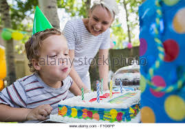 blowing out candles birthday cake boy stock photos u0026 blowing out