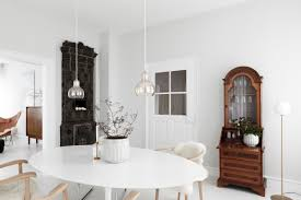 earthly and ethereal an apartment makeover by studio oink white dining room in a luxe minimalist apartment remodel by studio oink in mainz