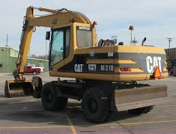 1998 caterpillar m318 mobile excavator item e8349 sold
