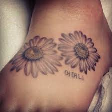 gerbera daisy tattoo on foot pictures to pin on pinterest tattooskid