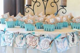 baby boy favors boy baby shower party favors above white wide table banner