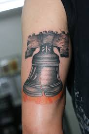 liberty bell tricep by lucky cat tattoo on deviantart