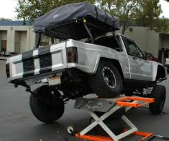 new jeep comanche rear shot of v8 comanche flexed only 2in lift front only contact