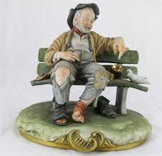 capo di monte ornament of tr on bench signed b merli 22cm