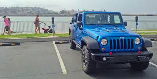 driving a jeep wrangler the jeep wrangler is unapologetically bad and that s what makes it
