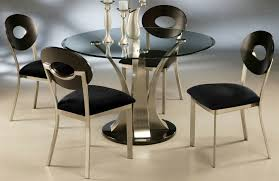 round black glass top dining table with silver steel vase plus