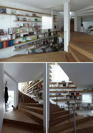Winding Staircase Design 12 Inspiring Examples Of Staircases With Bookshelves Contemporist